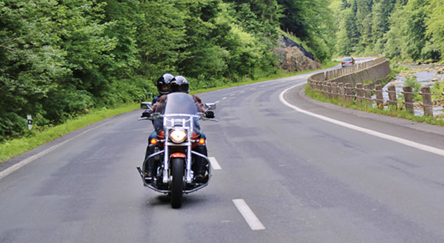 motorcycle with two riders on open road